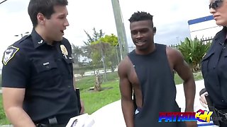 black smuggler gets abused by busty cops in truck