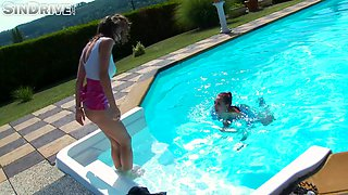 Lesbian chicks in sexy clothes fuck in a swimming pool