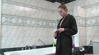 Busty brunette babe Zara masturbates in the shower