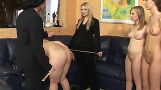 Nasty girl gets her ass hit with a stick in front of her friends