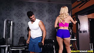 curvy blonde milf in the gym playing with a dick