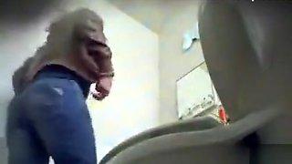 Cute maid piddles on a hidden camera
