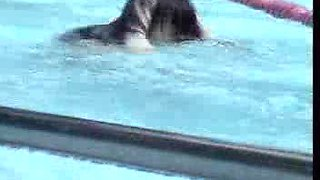 Down blouse in swimming pool