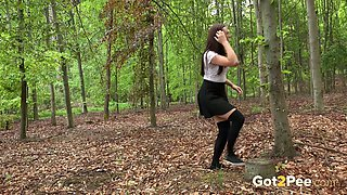 Hot long legged sporty brunette teen in the woods pissing