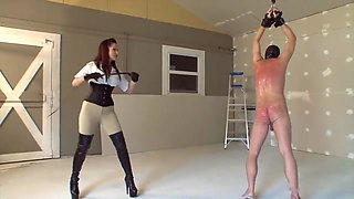 Strung up slave getting whipped by brunette mistress