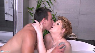 Soapy bathtub action with granny Tamara B. pleasing a young stud