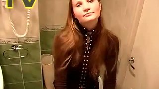 Titless cute redhead teen Galina sits on toilet bowl and pisses