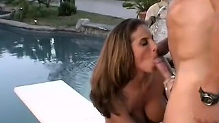 Sexy chick gets her man to lick her clit and finger her by the pool