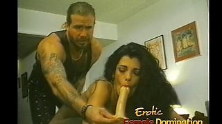Tattooed stud dominated by a beautiful girl in the bedroom