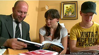 Pretty college girl and her fellow study with their kinky teacher