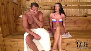 Attractive girl gets her pussy licked actively in a sauna