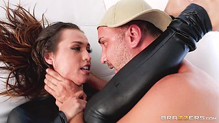 Kelsi Monroe wears a latex outfit while riding a cock