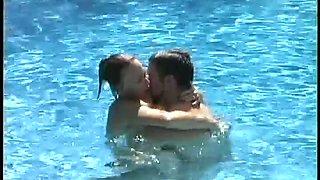 Nice bikini brunette gets poked doggy in the swimming pool