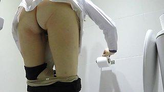 Sexy nurse in the toilet