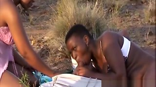 Two African Chicks Sucking And Banging Outdoors