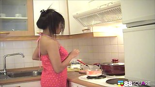Solo babe Beau Arpinya has to moan while she masturbates in the kitchen