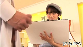 Gorgeous japanese chick shows off tits and gives blow job