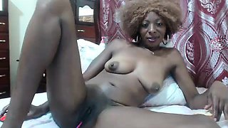 Milk and toys show from camgirl on webcam