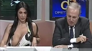Italian woman flashes her giant tits on TV show
