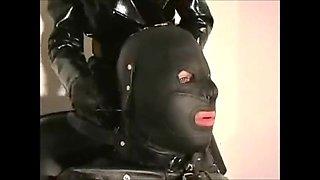 Leather slave muzzled