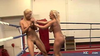 Two busty blondes are wrestling naked