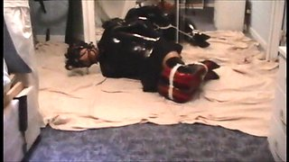 Kathy hogtied and struggling