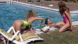 Incredibly seductive girls fuck dirty in a foursome outdoor  by the poolside