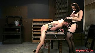 Horny mistress plays with her poor male toy