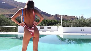 Tempting tanned babe with jewel plug in her anus Maria masturbates pussy by the pool side