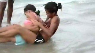 Dominican girls sexy wrestling on beach body to body