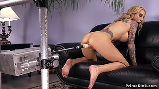 Huge tits blonde fucks machine on sofa
