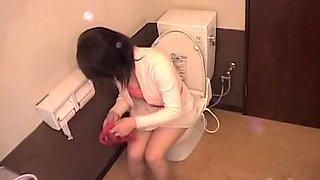Japanese bimbos taking a piss in the toilet on hidden camera