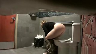 Women caught peeing in toilet
