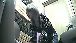 Blonde skinny girl in the public toilet room flashes her red panties
