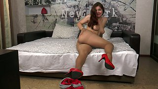 Sensational redhead teen babe on the bed stripteases on cam