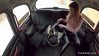 Lady in black stockings fucks in fake taxi