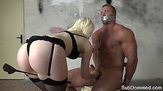 Femdom mistress tugging slaves cock