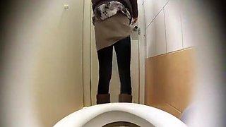 Woman takes a leak in toilet