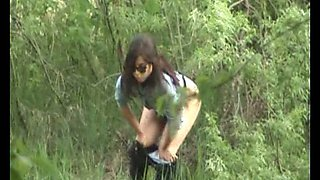 Brunette white chick in sunglasses pisses in the woods