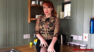 Red XXX strips and fingers her pussy in the kitchen