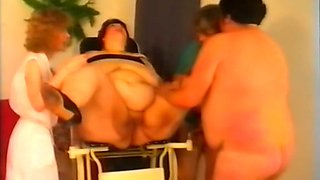 German SSBBW brunette milf sits on the chair and spreads her legs