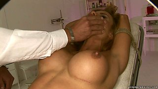 Perverted doctor teases the pussy and nipples of tied up busty chick