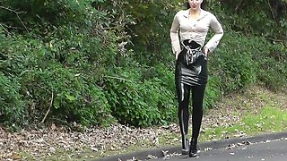 Lady black latex skirt outdoor