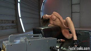 Busty machine babe stuffed in wet pussy