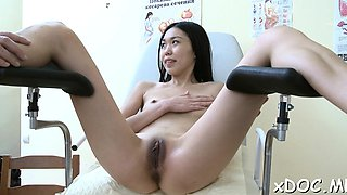 Hot babe is showing her shaved pussy to her doctor