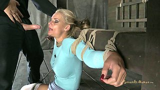 Alluring bondage slave in stockings having her tits pegged in BDSM