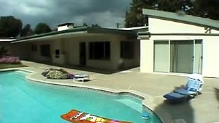 Big breasted ebony chick blows a black dick by the pool