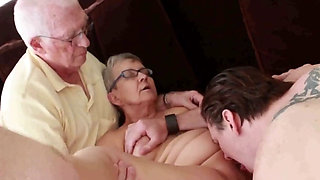 Granny fucks younger man with hubby besides her