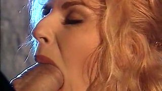 Sensational blonde milf deepthroats a meaty dick on her knees