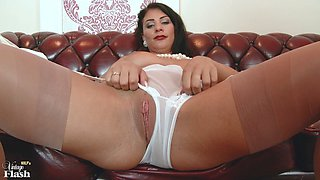 Busty milf got horny on the couch and spit-shines her cunt